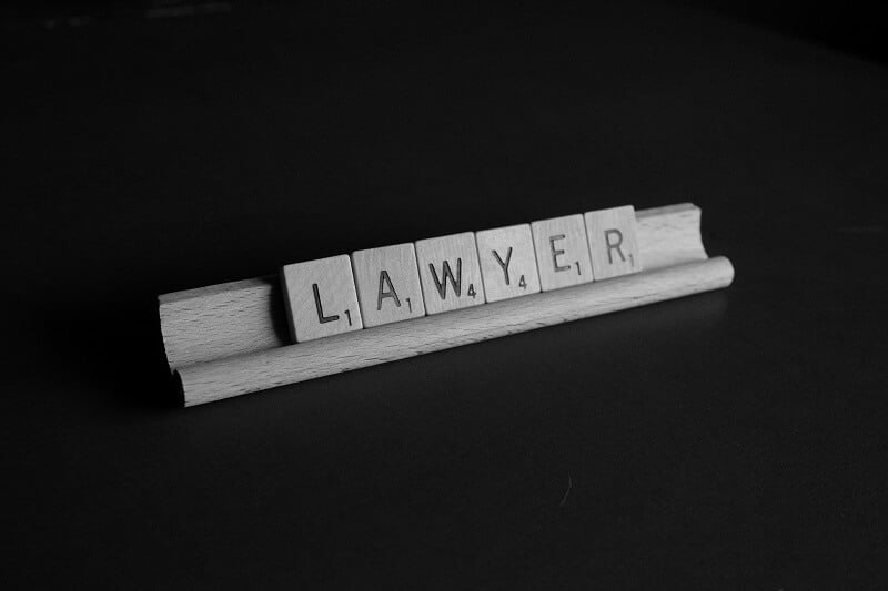 lawyer spelled out in scrabble tiles